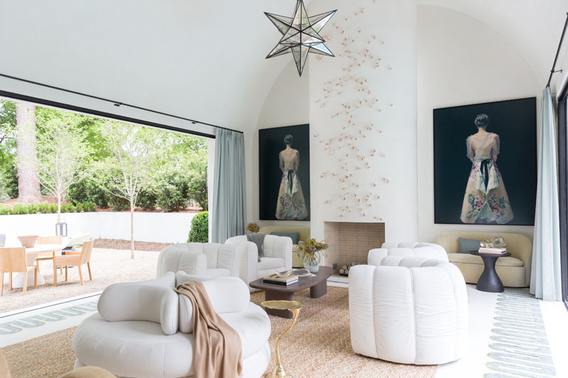 The pool lounge, complete with sliding doors by Panoramic Doors that open on either side, was designed by Melanie Turner Interiors. Turner is one of the showhouse's honorary co-chairs.