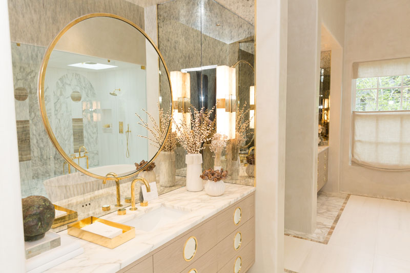 The master bathroom features tile by Source, cabinetry by Karpaty, and stone by Ciot.