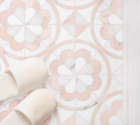 """Inspired by the timeless style of encaustic tile, Encaustic Flower presents an eight-petaled, two colored """"flower"""" cut from a variety of colorful marble."""