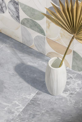 Moon Cosmati is composed of bisected circles of rich veined stones in a complex pattern.