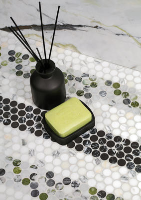 Penny Lane is a take on penny-round mosaics, elevated in an artistic fashion through the use of luxe natural stone and presented in a true penny size, in an offset pattern.