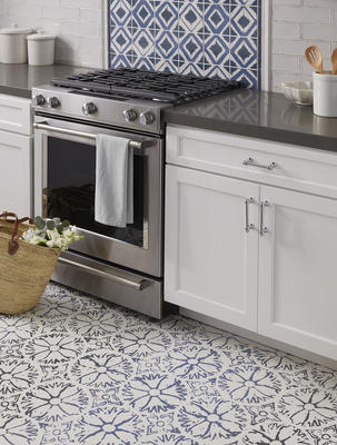 On the floor is Annie Selke Aylin in Blue, while Shadow in Navy makes up the backsplash