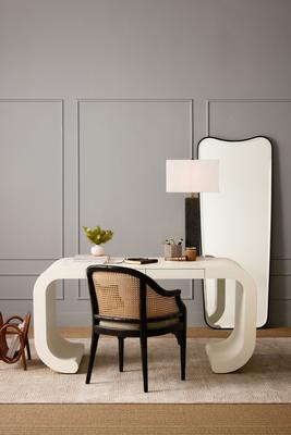 Vanora desk, Elena dining chair, and Faunus table lamp, and Gage mirror.