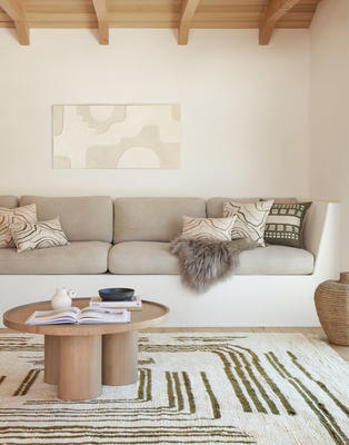 Earth Maze Moroccan Shag Rug and Pillows by Élan Byrd styled with the Delta Round Coffee Table
