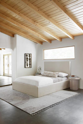 Nomad Rug and Canyon Pillow by Élan Byrd styled with the Paxton Slipcover Bed and Luna Side Table