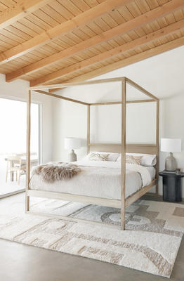Oasis Rug and Canyon Pillow by Élan Byrd styled with the Keiry Canopy Bed and Luna Side Table