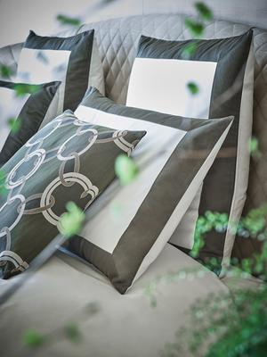 Bold sheet set and euro pillowcases in Milk-Aloe styled with Luxury Chains decorative pillow in Aloe-Savage Beige.