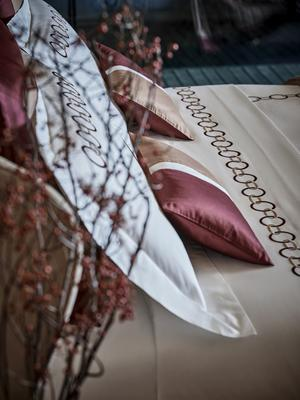 Links Embroidery duvet cover and sheet set in Amaryllis-Camel paired with coordinating Bold boudoir pillows.