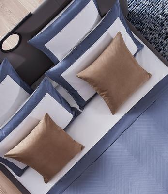 Herringbone duvet cover in Dark Azure styled with Bold sheet set and euro pillows in Milk-Dark Azure as well as Luxury Suede decorative pillows in Camel.
