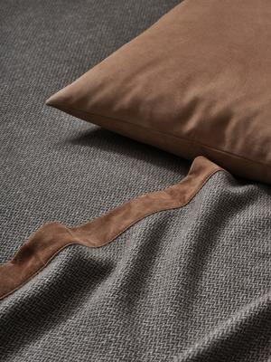 Tuileries throw in Beige-Aloe with Luxury Suede decorative pillow in Camel.