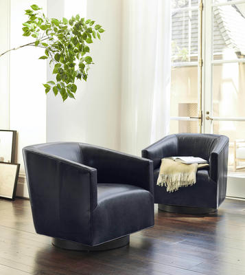 Cooper Swivel chairs in Mont Blanc Blue Smoke Leather
