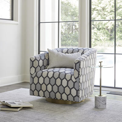 Cooper Swivel Chair shown in the exclusive Kravet Jaora Mineral fabric