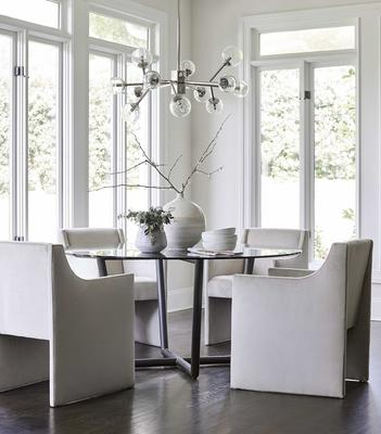 The Modern Round Table with the Edie Chair in performance velvet