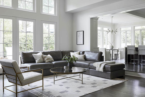 Franco Sectional in Mont Blanc Wolf Leather, the Vienna Table and Major Chair