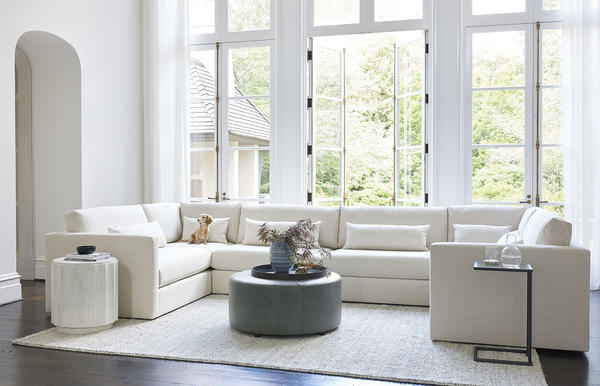 The Hayes Sectional shown in performance fabric with a Franny 36 Ottoman
