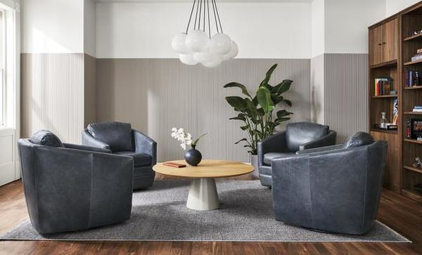 Ford swivel chairs, Decker coffee table and Humboldt chandelier