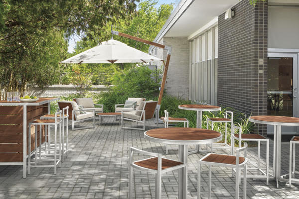 Cumulo patio umbrella and Montego counter table and stools