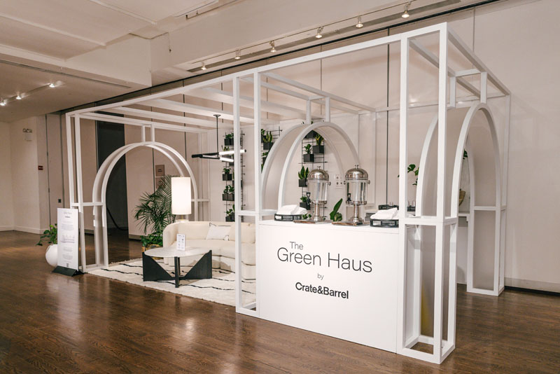 The Green Haus lounge by Crate & Barrel focused on sustainability and featured earth-friendly products, a QR code for guests to calculate their carbon footprint, and cold-pressed juices.