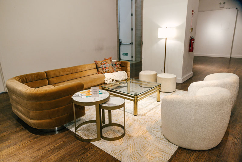 Additional lounge seating was provided in the main lounge, featuring items from Flor, Currey & Company and Annie Selke.