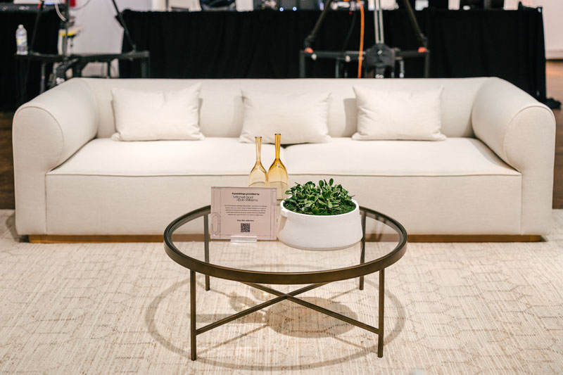 In the theater, a lounge vignette by Mitchell Gold + Bob Williams featuring pieces from the company's forthcoming collection with designer Brigette Romanek