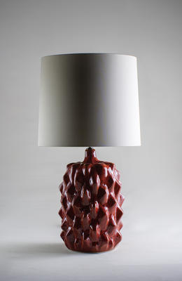 The vibrant and fiery Red Magma finish is new to the Baobab lamp, and perfectly complements the natural palette of decorative and lustrous glazes. Inspired by the form and texture of a Bajan seed pod, each Baobab takes on a life of its own. The alchemy of firing ensures that no two Baobabs will ever be identical.