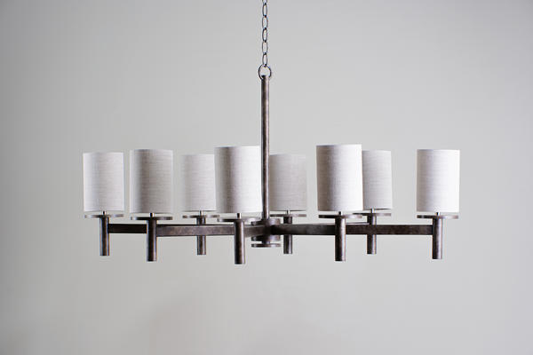 The ever-popular Neptune chandelier is now available in a smaller size. Still with its simple character very much intact, the Small Neptune is formed of a framework of linear struts and works perfectly in smaller areas with limited headroom.