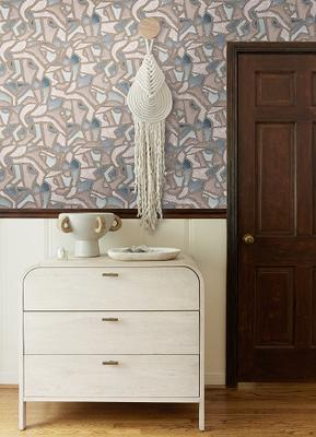 Mosaic wallpaper by Malene Barnett styled with the Brooke three-drawer dresser and Arteriors Clyde centerpiece