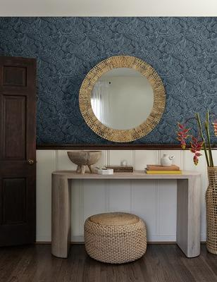 Bequia wallpaper in Dark by Malene Barnett, styled with the Luna console table and Vela pouf.