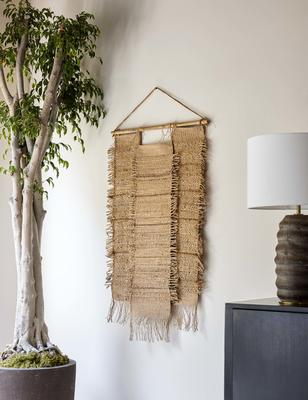 Woven with natural jute and hemp fibers, the Ukiah wall hanging is the perfect textured accent for a refined space. Its broad design spreads out rather than up making this the ideal wall decor to add a significant amount of artisanal texture to a living space like a bedroom or living room.