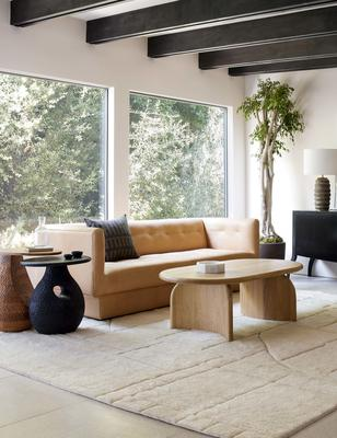 The Maleena rug stylized with the Ezri leather sofa, Corso side table, Gem side table and Ada oval coffee table.