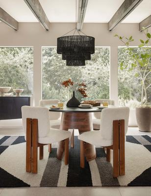 Hidara rug styled with the Sydney armless dining chair, Alder dining table, and Chavette chandelier.
