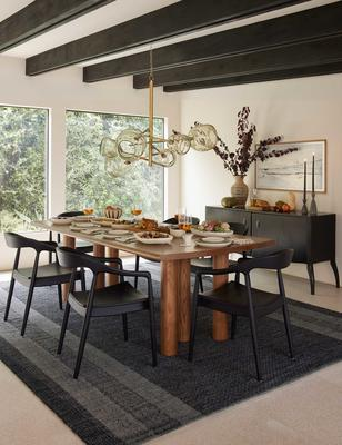 Adentro rug styled with the Throop dining table, Ida dining arm chair, and Backstreet chandelier.