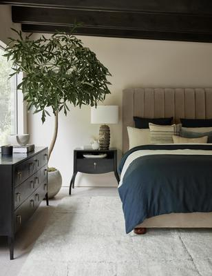 Costa rug styled with the Evelyn platform bed, Anabella nightstand and Anabella dresser.