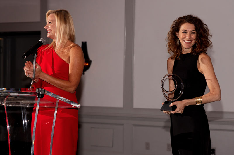 Katie Miner and Ellen McGauley present one of the Southeast Designer of the Year awards onstage.