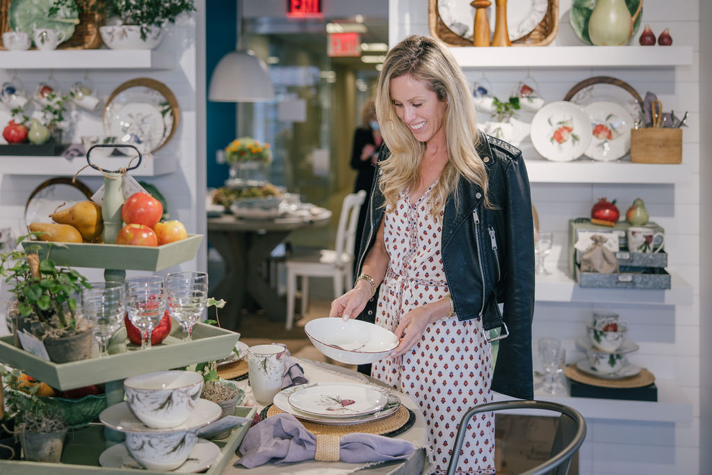 Amanda Gluck, founder of the Fashionable Hostess blog, viewing product during her Tastemaker Takeover at the newly renovated Portmeirion showroom.