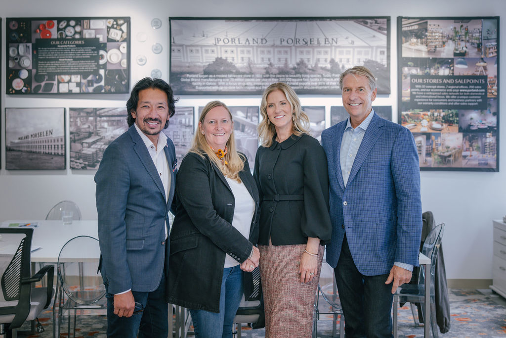 Creative Tops partner Milton Tjin (left), vice president Paul Pogor (right) and chief development officer Lisa Knierim (second from left), pictured with Kristi Forbes of 41 Madison (second from right), traveled to debut their new showroom in-person on the 18th floor.