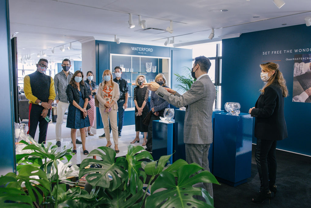 Fiskars group retail marketing manager Douglas Yuen and director of public relations and special events Michelle Westcott-Richards tours a group through the Waterford Lismore collection on Designer Day.