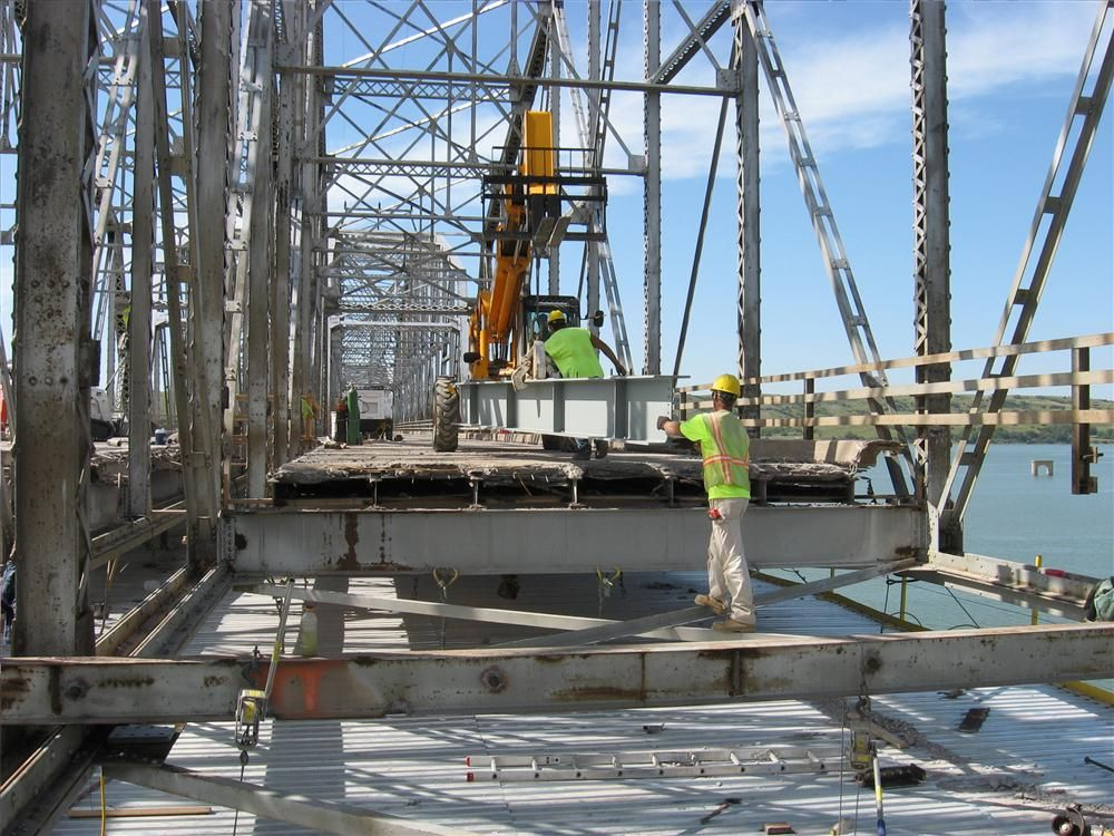 Crews with Heavy Constructors Inc., of Rapid City, S.D., are replacing every third floor beam on each truss to strengthen the structure to allow for heavier vehicles to cross; the other two beams will remain.