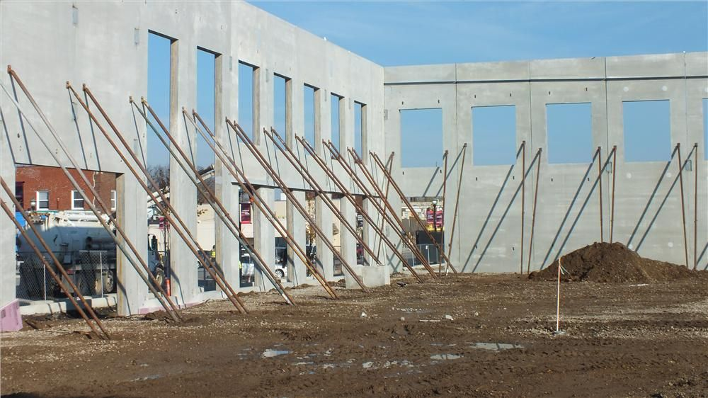 By late October, the exterior walls of the 37,000 sq. ft. (3,437.4 sq m) building were in place and braced.