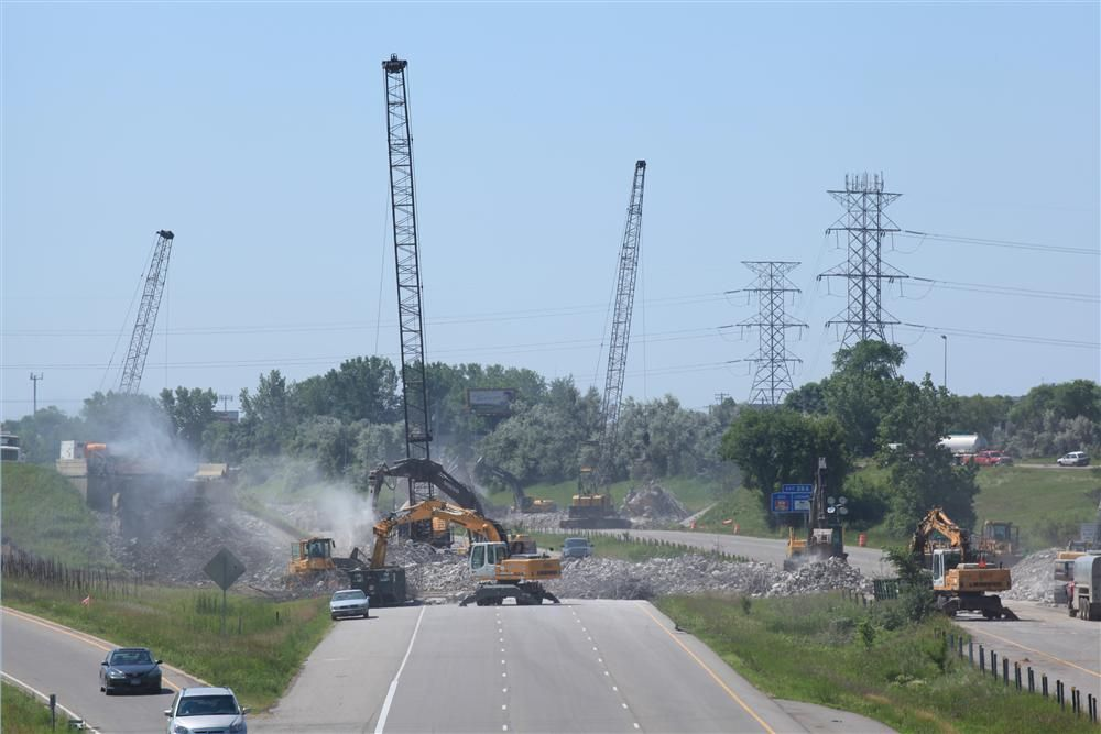 The fine mist of a huge water spray keeps construction dust down at the site of the TH-10 bridge removal.
