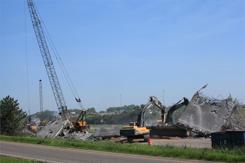 American and Terex cranes with demolition support from Liebherr and Cat equipment occupy six lanes of I-35W over a weekend closure of the high volume freeway to remove the TH-10 bridges.