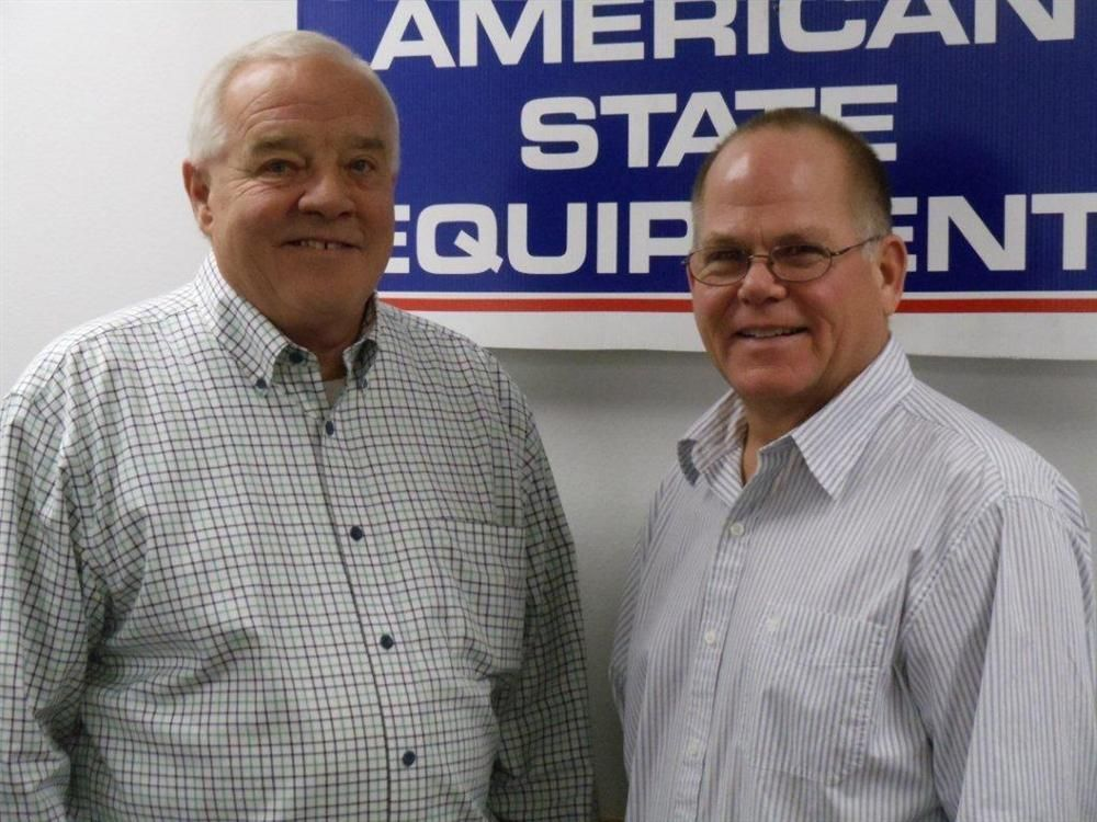 Tom Lamberg (L) turned over his duties to Randy Manteufel as of Nov. 30 and officially retired Dec. 31.