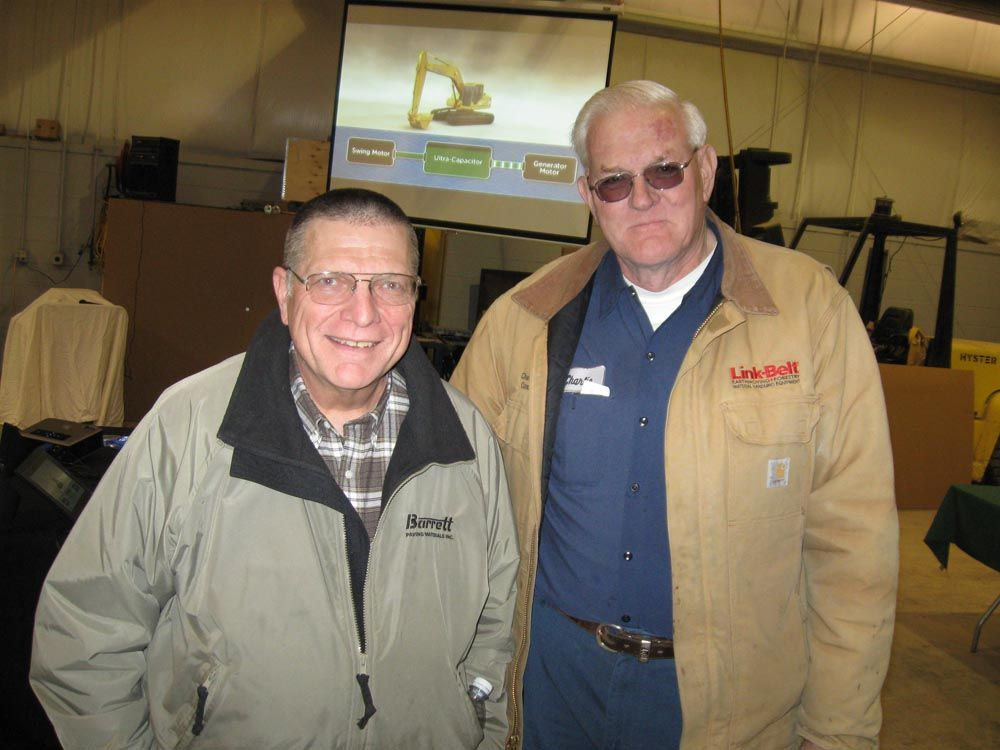 Steve Barrett (L) of Barrett Paving Materials catches up with Charlie Jergens of Charles Jergens Construction.