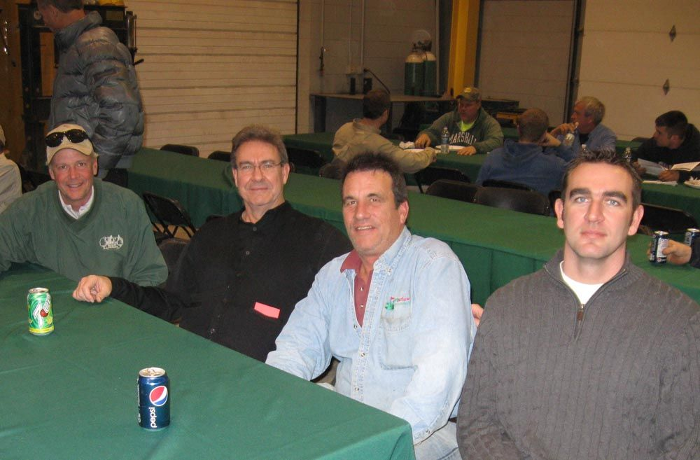 (L-R): Dan Rindler of Rindler Landscape; Tom Stivison, president of Columbus Equipment;  Tom Topp of Topp Shape Enterprises; and Josh Stivison of Columbus Equipment gather around for a little lunchtime conversation.