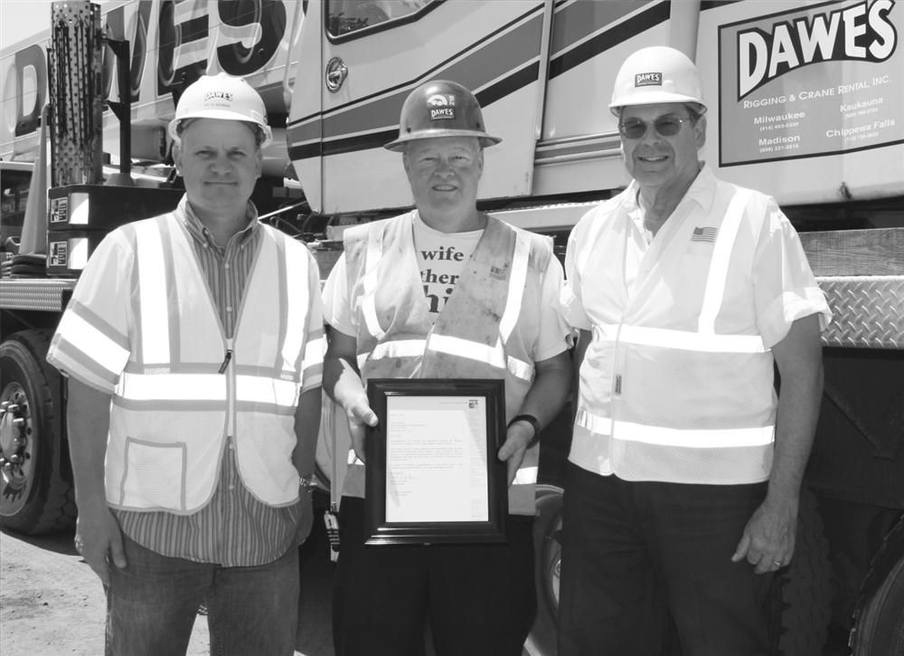 Operator Larry Kraemer (C) with Pete Nowak (L) and Rick Peters, safety managers.