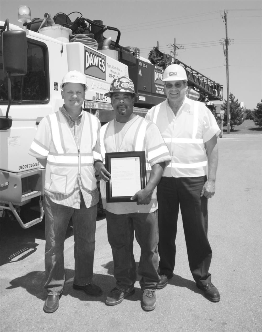 Operator Curtis Smith (C) with Pete Nowak (L) and Rick Peters, safety managers.