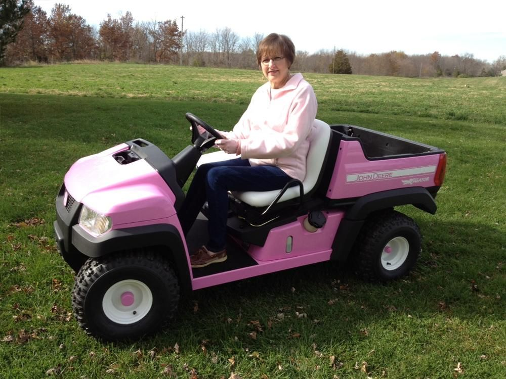 Diane Jone, of West Pont, Ind., the winner of the Pink Gator Fundraiser, takes her prize for a ride.