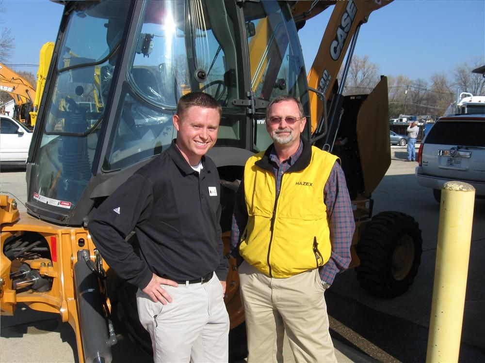 Westen Sublett (L) of Diamond Equipment joins Brad Hazelwood of Hazex to get a closer look at his newly purchased Case 580 Super N backhoe.