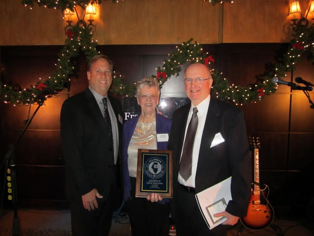 IED President Barry Heinrichs (L) presents Hugh Goulding (R), IED executive secretary, with an IED plaque held by Hugh's wife, Adrienne.