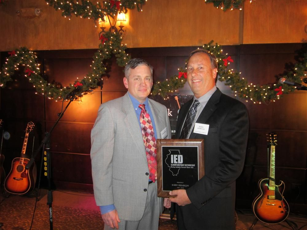 Incoming 2013 IED President Robert Sloan (L) presents Barry Heinrichs with the president's plaque for his service to IED.